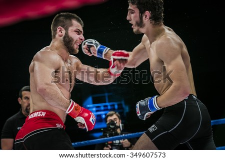 Chelyabinsk, Russia - December 5, 2015: athlete mixed martial arts fighter gets cross hand to his opponent during Cup of Russia MMA - stock photo