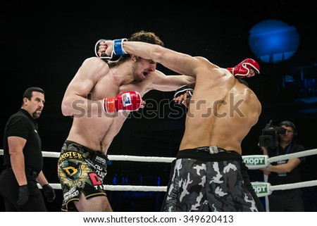 Chelyabinsk, Russia - December 5, 2015: final fight of MMA fighters. referee John McCarthy during Cup of Russia MMA - stock photo