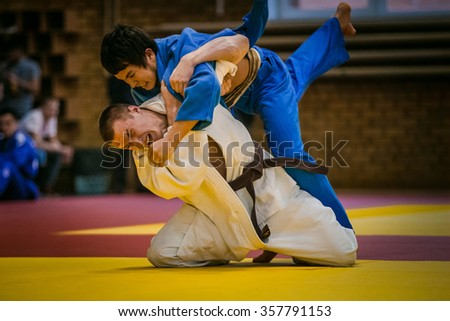 Chelyabinsk, Russia -  December 20, 2015: final match between two young athletes judoists during All-Russian competition on judo of memory Grigory Verichev - stock photo