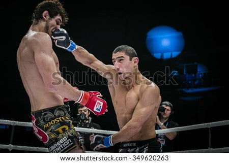 Chelyabinsk, Russia - December 5, 2015: mixed martial arts fighter gets jab hand to head of his opponent during Cup of Russia MMA - stock photo