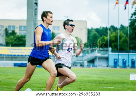 Chelyabinsk, Russia - July 05, 2015: blind men athletes run 800 meters during Championship of Russia on track and field athletics among the blind, Chelyabinsk, Russia - July 05, 2015 - stock photo
