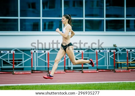 Chelyabinsk, Russia - July 05, 2015: girl athlete running a sprint distance during Championship of Russia on track and field athletics among blind - stock photo