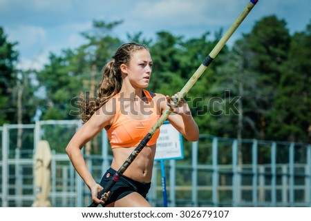 Chelyabinsk, Russia - July 24, 2015: young girl athlete ready for attempting pole vault during National competitions in memory of G. I. Nicewhen athletics - stock photo
