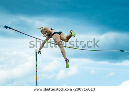 Chelyabinsk, Russia - June 10, 2015: female athlete competing in pole vault during universities championship of Chelyabinsk region in athletics - stock photo
