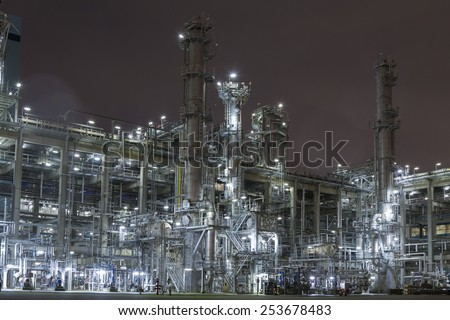 chemical factory by night - stock photo