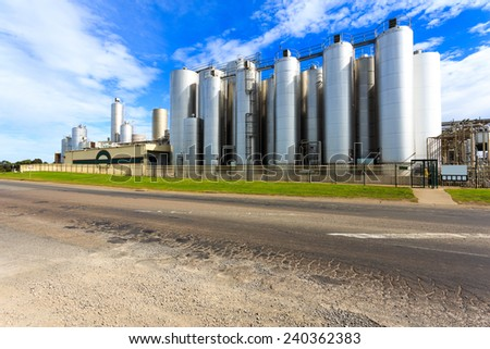 chemical factory exterior against skyline - stock photo