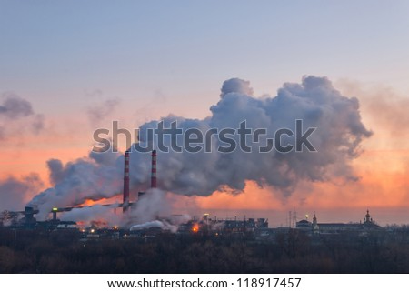 Chemical factory in the morning, with pipes and smoke, long exposure - stock photo