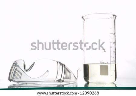 chemical glasses and flask, filled with liquids, white background - stock photo