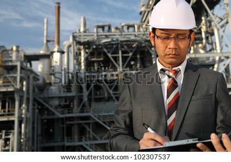 chemical industrial engineer write on board serious - stock photo