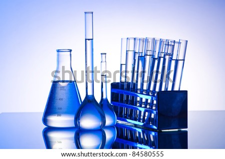 Chemical lab with glass tubing - stock photo