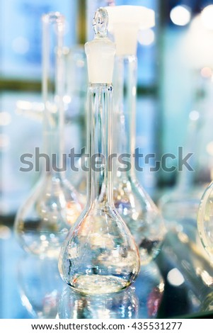 Chemical laboratory glassware, flasks. Abstract background. Shallow depth of field - stock photo