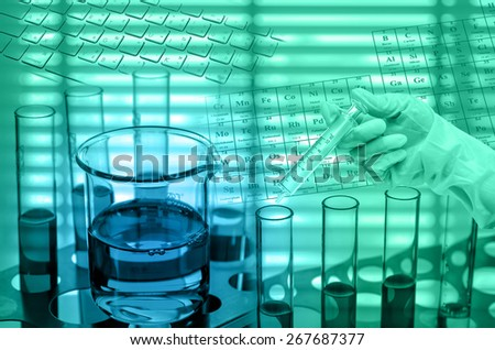 Chemical Laboratory,Scientist holding medical injection syringe with test tube - stock photo