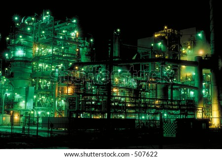 Chemical plant at night - stock photo