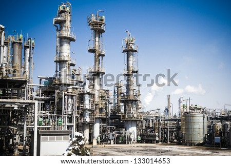 Chemical plant in the blue sky - stock photo