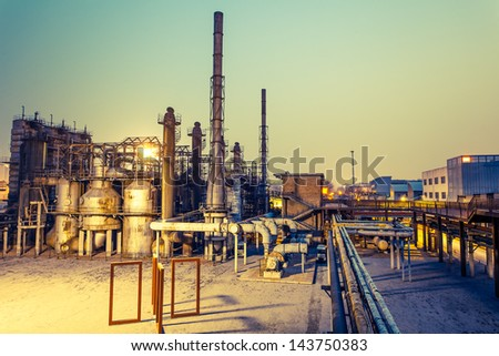 Chemical plant in the sunset. - stock photo