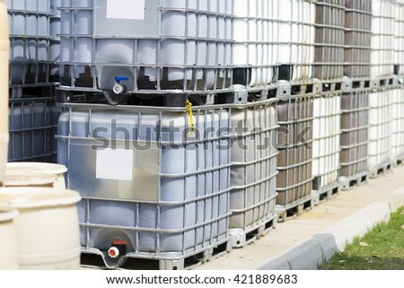 Chemical Plant, Plastic Storage Drums, Big Barrels - stock photo