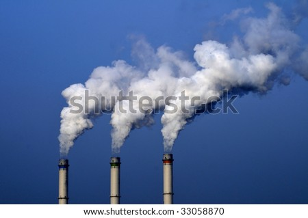 Chemical plant/power station air pollutions - stock photo