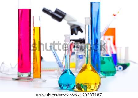 Chemical scientific laboratory stuff microscope test tube flask pipette - stock photo