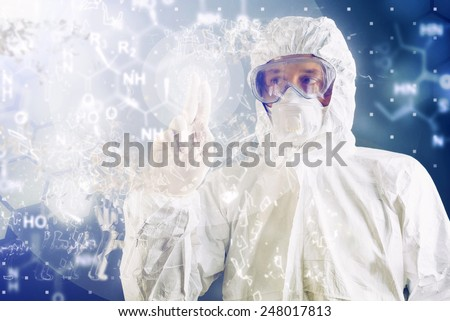 Chemical Scientist in Protective Work wear Analyzing Formula on Virtual Screen during Chemical Test - stock photo