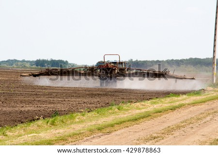 Chemical spraying agriculture - stock photo