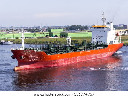 chemical tanker ship in the harbour of amsterdam during a manouvre - stock photo