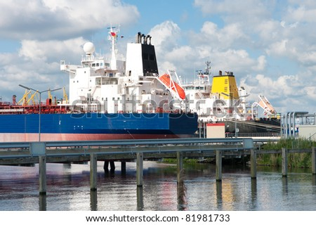 chemical tankers moored in amsterdam harbor - stock photo