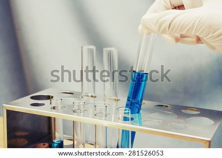 chemical test tube at science lab - stock photo
