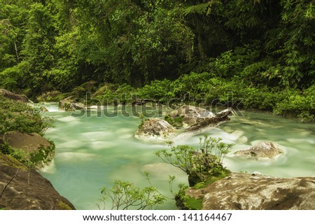 Chemicals contained within the waters of two rivers react to create the vivid blue color of Rio Celeste in Costa Rica. - stock photo
