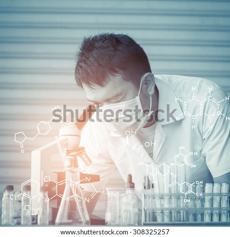Chemist is analyzing sample in laboratory - stock photo