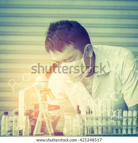 Chemist is analyzing sample in laboratory - stock photo