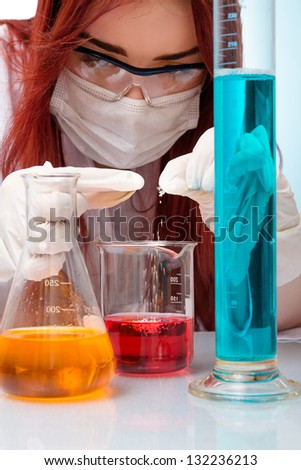 Chemist woman with test tubes - stock photo