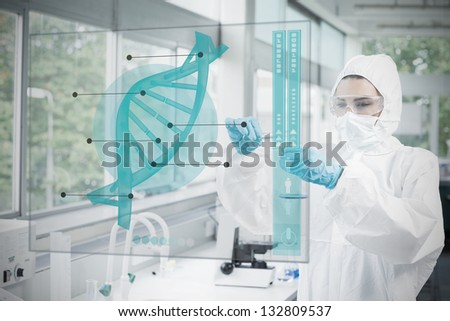 Chemist working cautiously with blue liquid and futuristic interface with dna diagram on it - stock photo