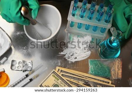 Chemist working in drug laboratory - stock photo