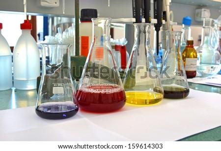 chemistry laboratory liquid bottles - stock photo