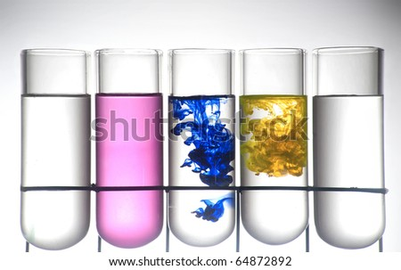 Chemistry recipient with ink color inside - stock photo
