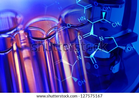 Chemistry science background with microscope and laboratory glass - stock photo