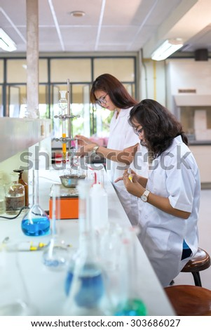 Chemistry students doing research in a chemistry lab - stock photo
