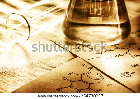 Chemistry with reaction formula in toning in closeup - stock photo
