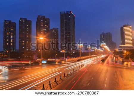 CHENGDU,CHINA - 31 Jan,2015:busy traffic at night at chengdu,china. - stock photo