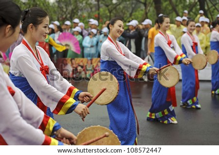 CHENGDU, CHINA - MAY 29: North Korean Pyongyang folk dancers perform in the 3rd International Festival of the Intangible Cultural Heritage.May 29, 20011 in Chengdu, China. - stock photo