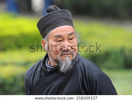 CHENGDU - JULY 2: Taoist priest at Qingyang monastery on July 2, 2013 in Chengdu, China. Taoism dates back to the 6th century B.C. and has around 20 million followers in the world nowadays. - stock photo