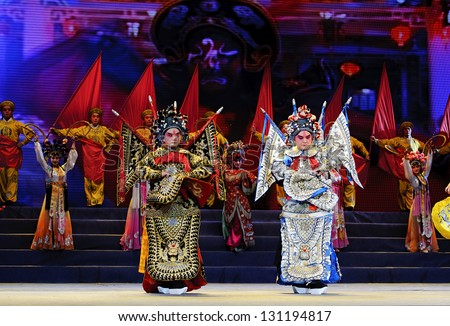 CHENGDU - JUN 10: chinese opera actor perform on stage at Jincheng theater.Jun 10, 2011 in Chengdu, China. - stock photo