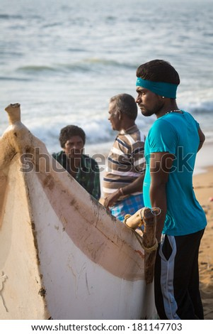 CHENNAI, INDIA-FEBRUARY 10: Fishermen on the beach Marina Beach on February 10, 2013 in Chennai, India. The beach runs from near Fort St. George in the north to Besant Nagar in the south. 13km - stock photo