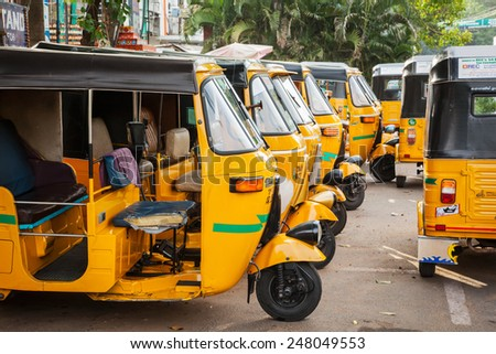 """CHENNAI, INDIA - JULY 25, 2009: Indian auto rickshaws in street. Auto rickshaws (aka  """"autos"""") provide cheap efficient transportation in many indian cities used instead of taxies for short distances - stock photo"""