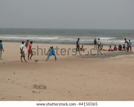 CHENNAI, INDIA - NOV 29 : Young Indian boys play cricket on the beach on Nov 29, 2009, in Chennai, India. It has been 4 years after the tsunami came ashore here. - stock photo
