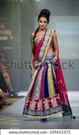 CHENNAI - JULY 21: A model walks on the ramp showcasing designer Anuradhaa Bisani work during the Chennai International Fashion Week runway on Jul 21, 2012 in Chennai , India. - stock photo