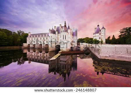 CHENONCEAUX, FRANCE - SEPTEMBER 24, 2011: Castle of Chenonceaux was built in 1513, it is located on the Loire Valley of France. Photo of a magic sunset at the castle yard.  - stock photo