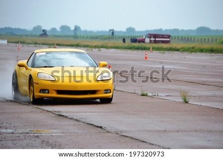 CHERKASSY, UKRAINE - JUNE 1: Chevrolet Corvette in Championship of Ukraine in drag racing during rainy weather, 1 June 2014, Cherkassy, Ukraine - stock photo