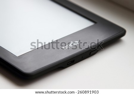 CHERKASSY, UKRAINE - MARCH 12, 2015: Amazon Kindle book reader - one of the most poplar readers for ebooks. - stock photo