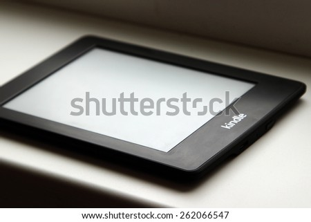 CHERKASSY, UKRAINE - MARCH 12, 2015: Amazon Kindle reader is one of the most poplar readers. - stock photo